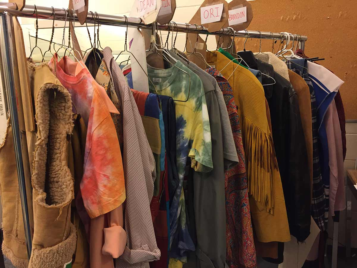 Some of the costumes on a rack