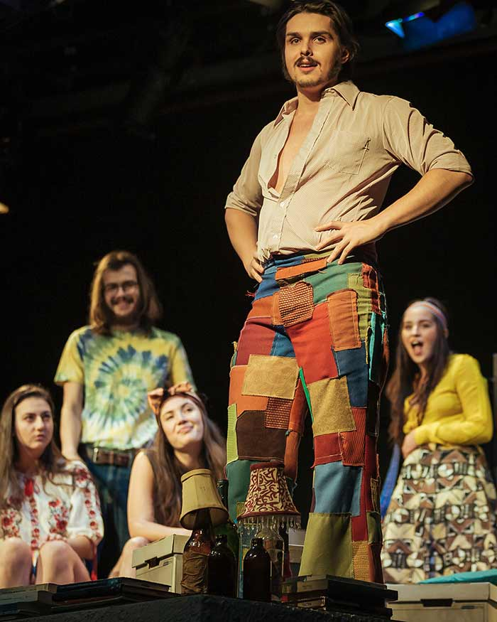 Actor Tomasz Pereira Nunes as Gerry in his patchwork pants on stage.